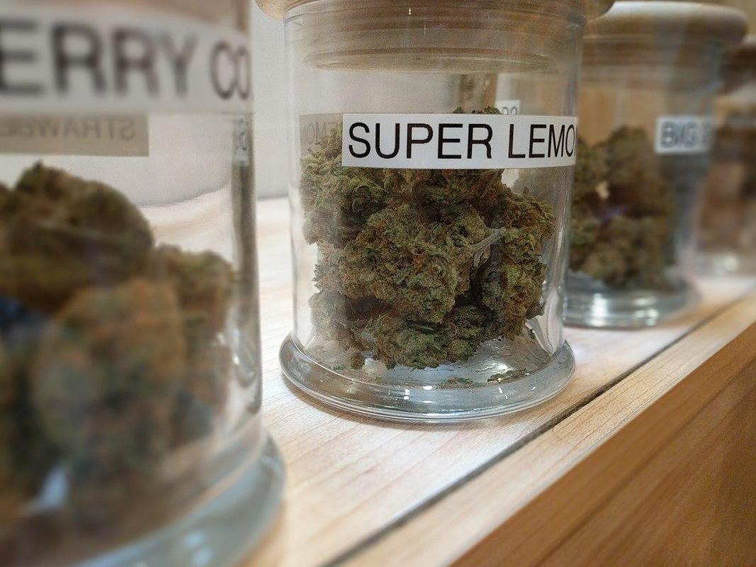 Cannabis strains in jars at a marijuana dispensary