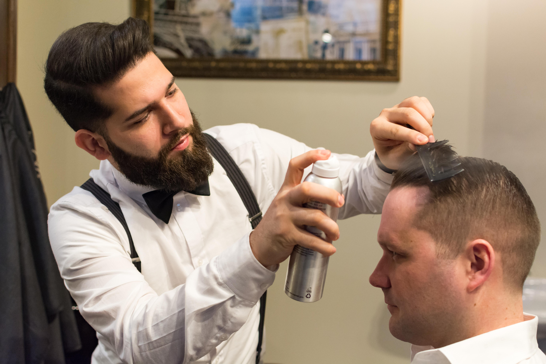 Goodman's barber Rami Natour executing a proper combover