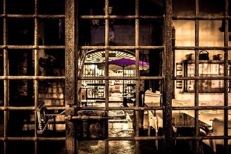Locked gate, restaurant beyond
