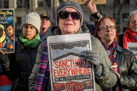 Participant holding a sign at the silent vigil outside ICE court building. Immigration advocacy groups, faith leaders, elected officials and supporters gathered at Foley Square outside the immigration court building at 26 Federal Plaza, in a solidarity action for Ravi Ragbir, New Sanctuary Coalition Director at his U.S. Immigration and Customs Enforcement (ICE) check-in, to speak out against ICEs harassment of immigrant communities and targeting of their leaders. (Photo by Erik McGregor/LightRocket via Getty Images)