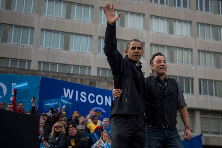 President Barack Obama alongside Bruce Springsteen waves to the crowd during a campaign stop in Madison, Wisconsin, on Monday, November 5, 2012. (Photo by Nikki Kahn/The Washington Post via Getty Images)
