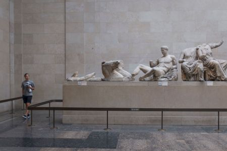 A visitor walks around the Parthenon (Elgin) Marbles in Room 18 of the British Museum, on 12th June 2018, in London, England.  (Photo by Richard Baker / In Pictures via Getty Images Images)