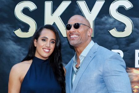 Actor Dwayne Johnson and his daughter Simone Alexandra Johnson attend the premiere of 'Skyscraper' on July 10, 2018 in New York City. (Photo by KENA BETANCUR / AFP)