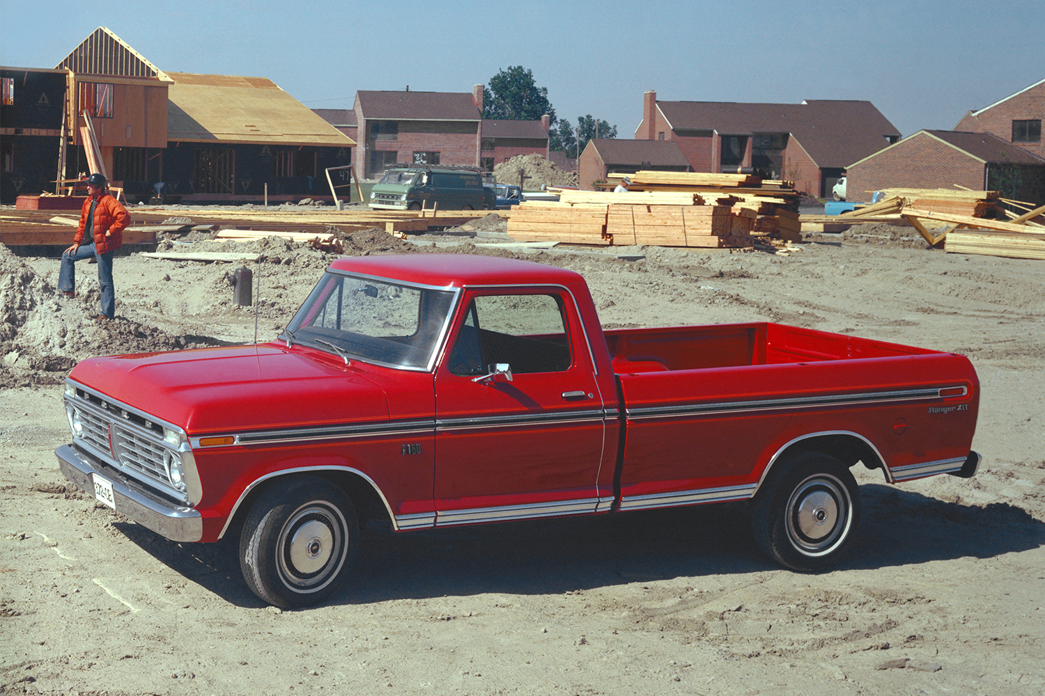 Old-school red Ford pickup truck on a worksite