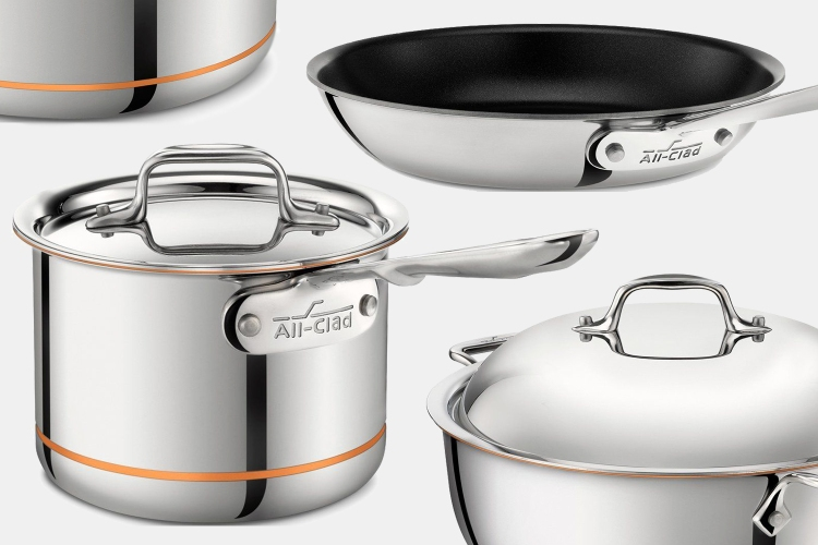 All-Clad Copper Core, stainless steel and nonstick pots and pans on a grey background. All of them are on sale at the Home & Cook website.