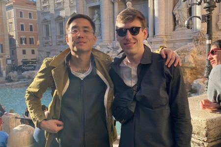 Two American men in front of Rome's Trevi Fountain