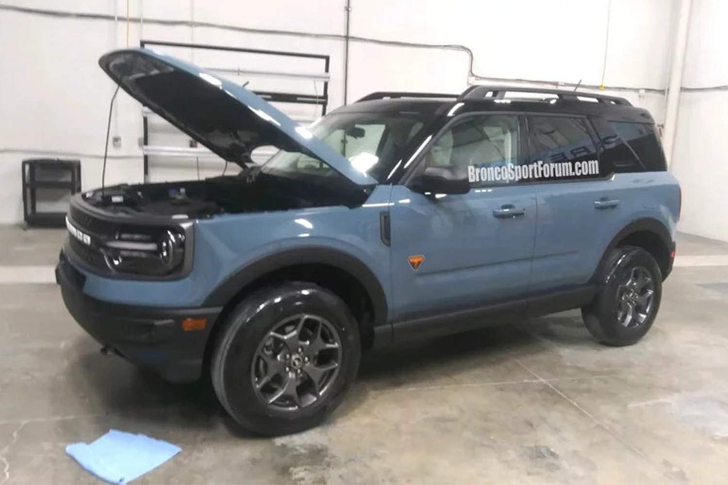 Leaked blue Ford SUV in a garage