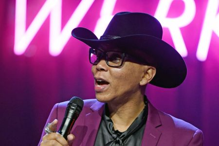 Drag queen RuPaul holding a microphone