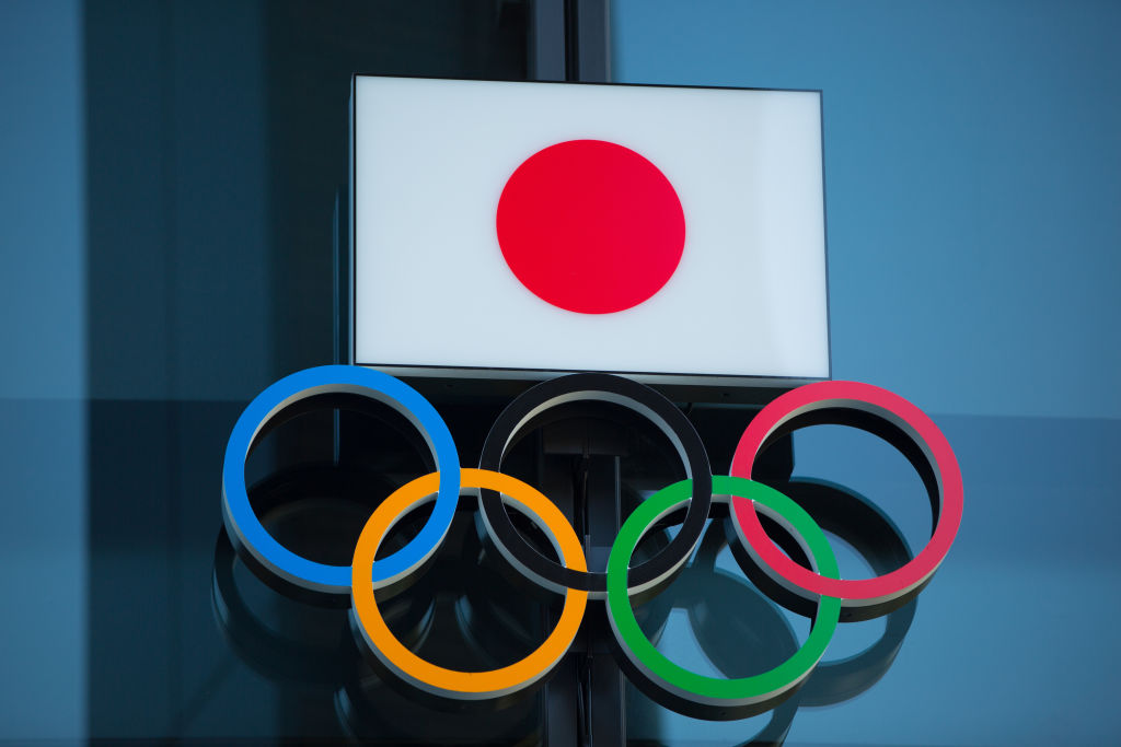 Japanese National Flag over the Olympic Rings symbol is seen