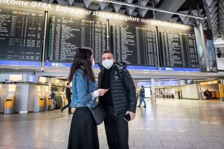Passengers with face masks pictured at Frankfurt Airport on March 12, 2020 in Frankfurt, Germany. (Photo by Thomas Lohnes/Getty Images)