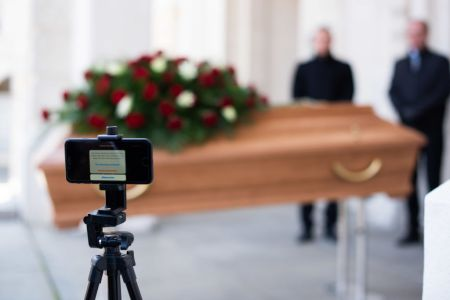 Employees of Bestattung Himmelblau undertakers rehearse the livestreaming of an upcoming funeral on March 24, 2020 in Vienna, Austria. (Photo by Thomas Kronsteiner/Getty Images)