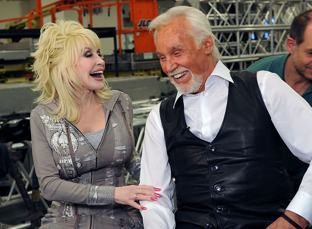Dolly Parton and Kenny Rogers backstage at the Kenny Rogers: The First 50 Years show at the MGM Grand at Foxwoods on April 10, 2010 in Ledyard Center, Connecticut. (Photo by Rick Diamond/Getty Images)