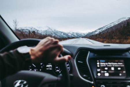 Man driving through Denali National Park in Alaska