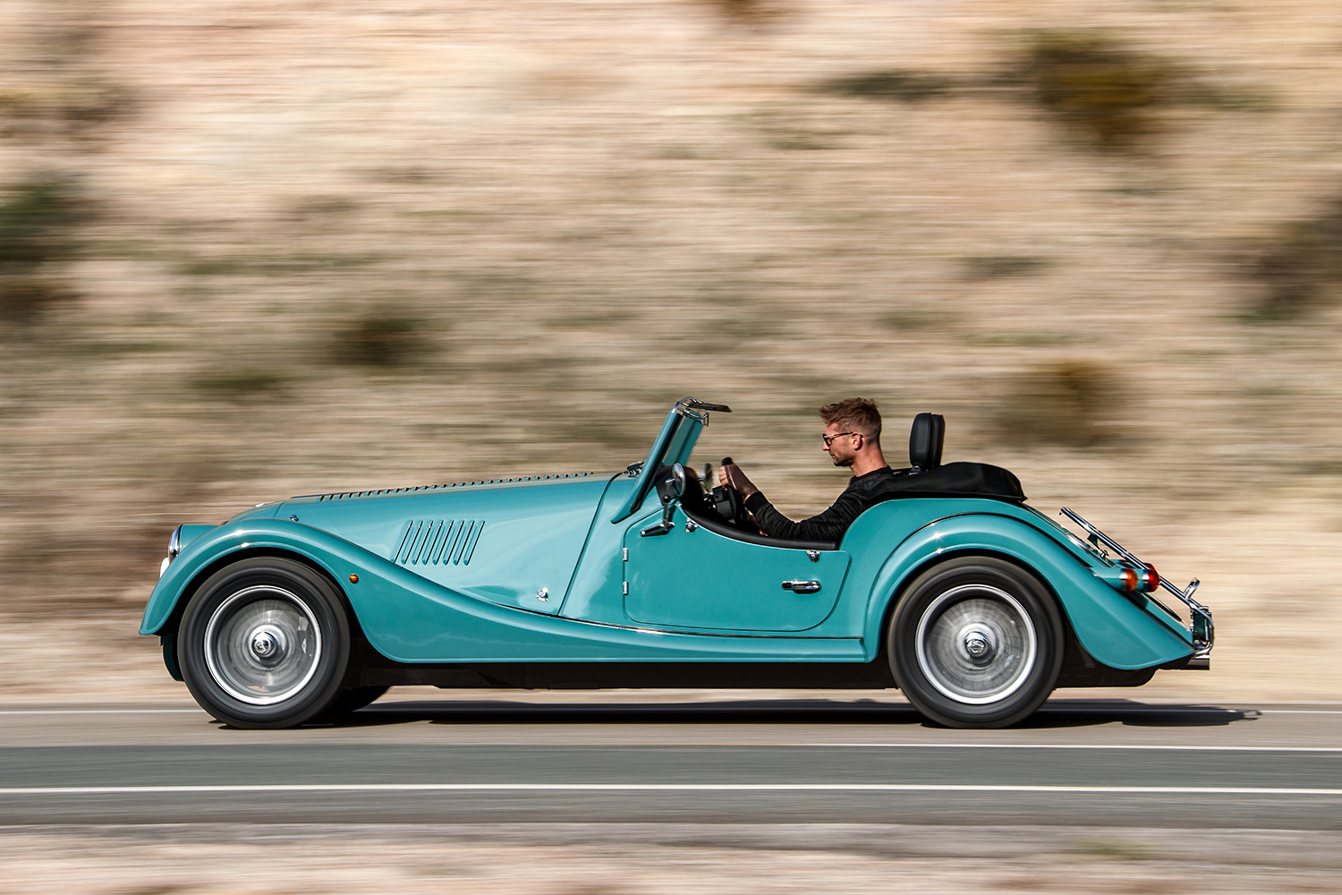 Two-seat roadster car driving