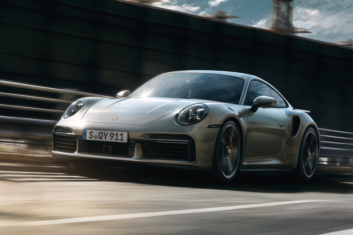 Porsche coupe driving on the highway