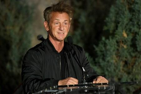 Actor Sean Penn standing at a podium