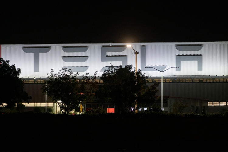 The exterior of Tesla's Fremont factory at night