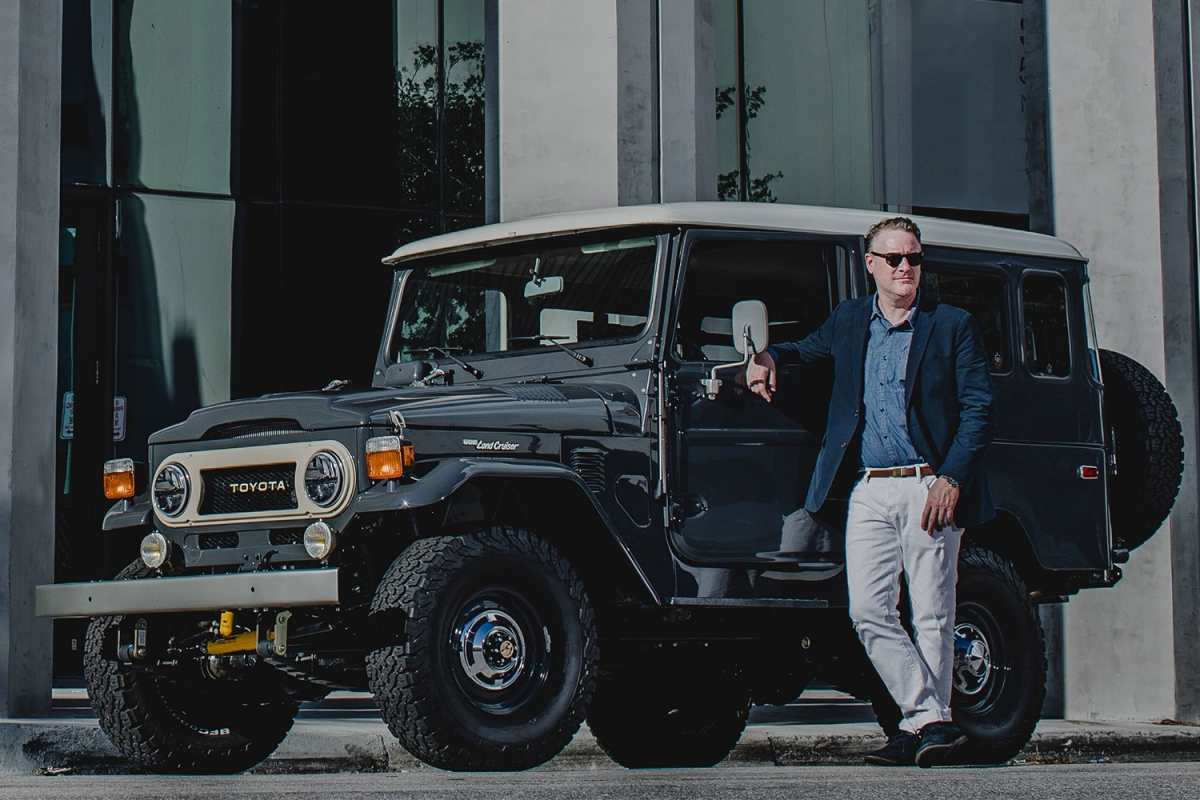 Menswear designer Todd Snyder next to an SUV
