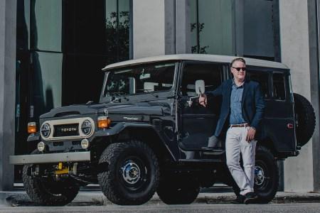 Menswear designer Todd Snyder next to an SUV