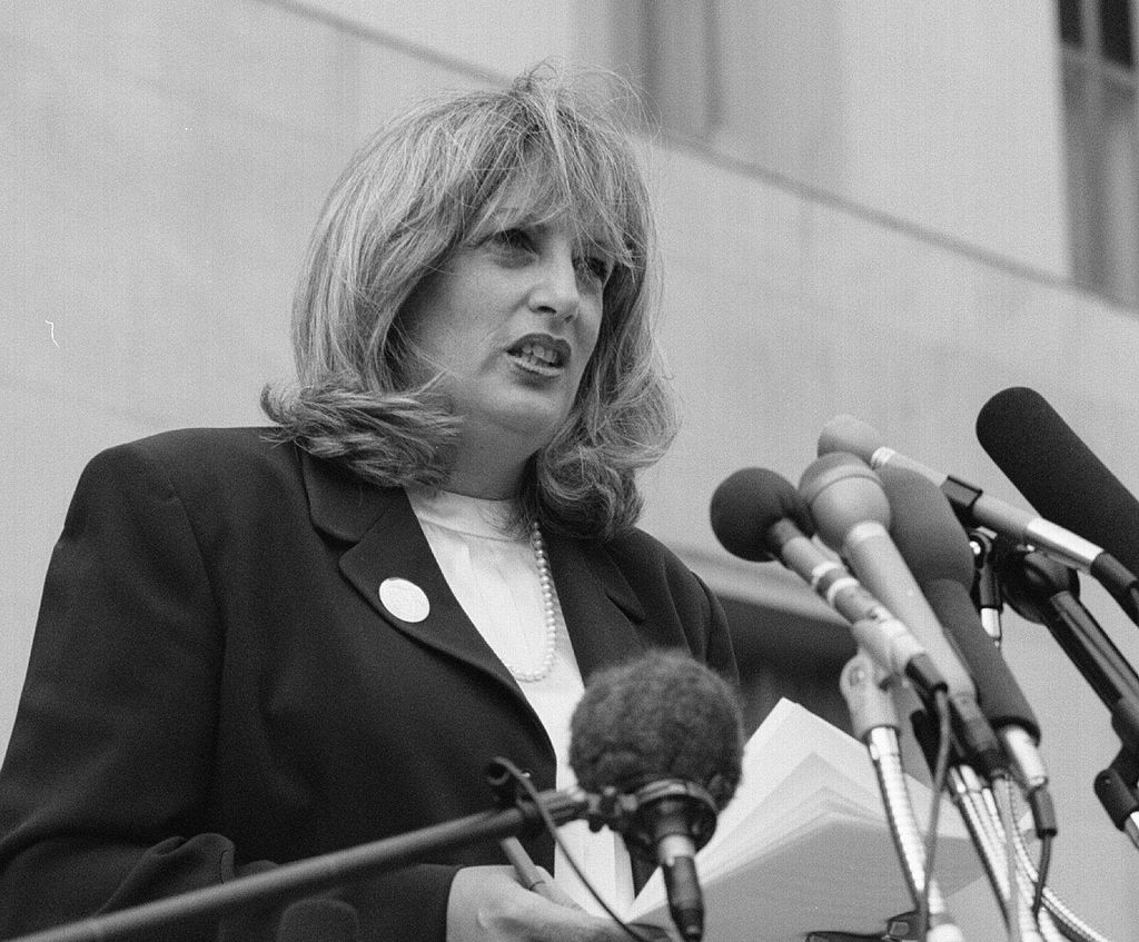 Linda Tripp speaks to reporters outside the US District Courthouse in 1998. (Photo by Larry Morris/The The Washington Post via Getty Images)