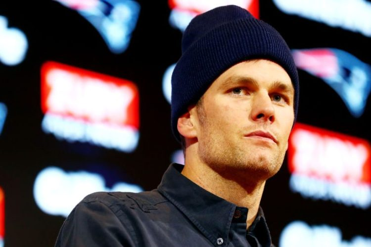 Tom Brady speaks with the media during a press conference. (Adam Glanzman/Getty Images)