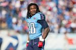 Chris Johnson, formerly of the Tennessee Titans, watches a replay. (Wesley Hitt/Getty)