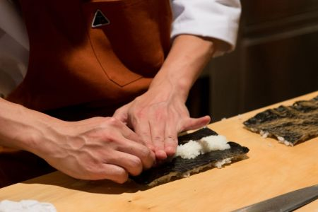 A view of food being prepared during a dinner with Masa Takayama (Photo by Noam Galai/Getty Images)