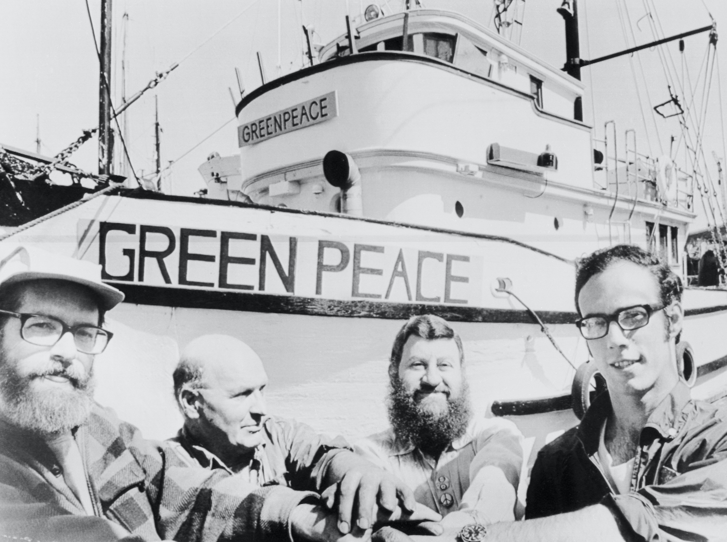 Men Seated near Greenpeace Vessel