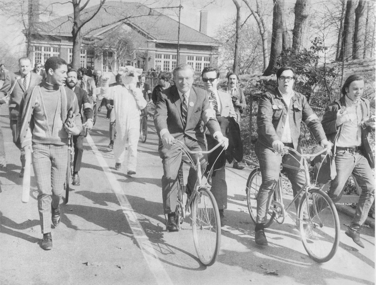 New York Governor Nelson A. Rockefeller rides a bike in Prospect Park, Brooklyn in observance of the first Earth Day.