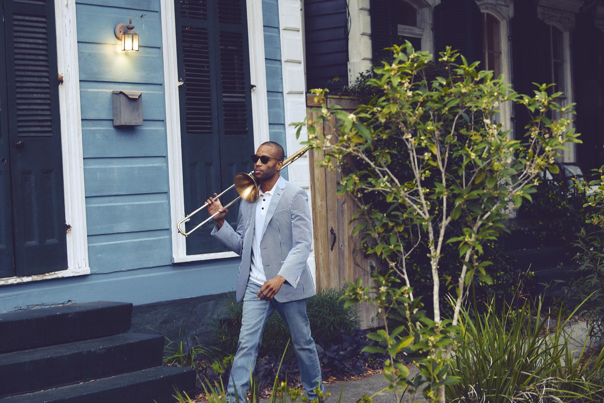 Trombone Shorty strolling through Treme wearing Salvatore Ferragamo, Rag & Bone, and BOSS
