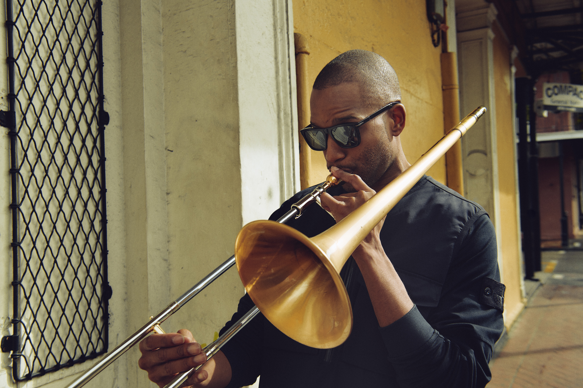 Trombone Shorty wearing David Beckham Sun and Stone Island in the French Quarter