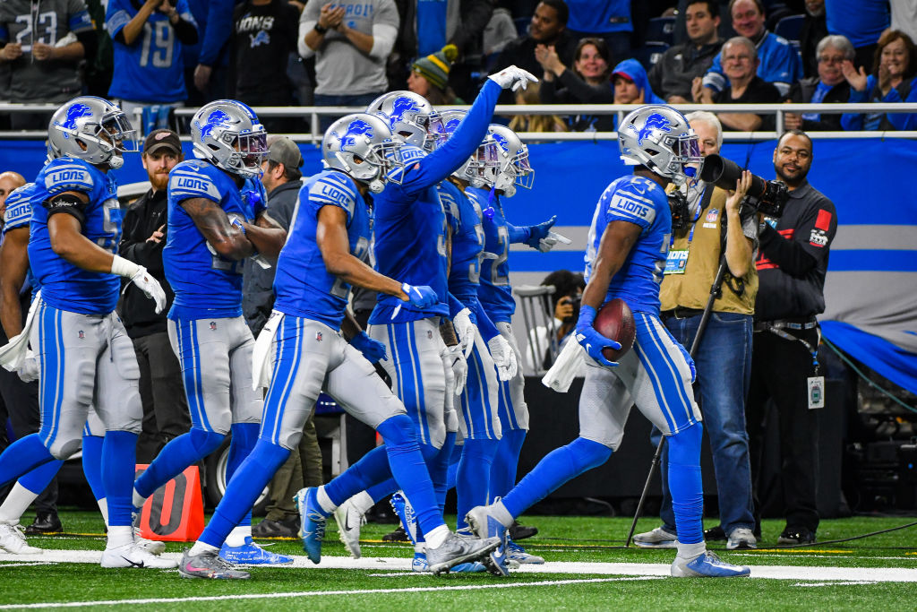 Detroit Lions cornerback Amani Oruwariye celebrates an interception with his teammates. (Steven King/Icon Sportswire via Getty)