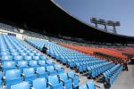 An employee of LG Twins watches a game at an empty stadium. (Chung Sung-Jun/Getty)