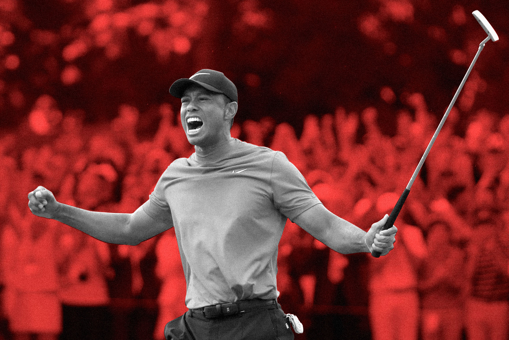 Tiger Woods celebrates on the 18th green after winning the Masters in 2019.