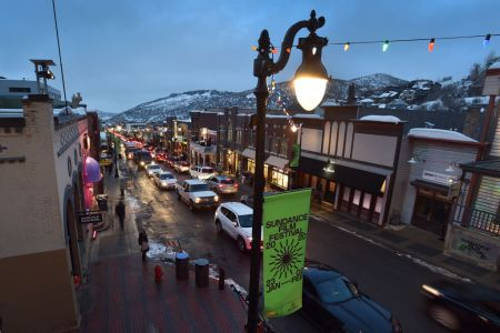 Vehicle traffic and pedestrians negotiate Main Street during the 2020 Sundance Film Festival on January 23, 2020 in Park City, Utah. (Photo by David Becker/Getty Images)