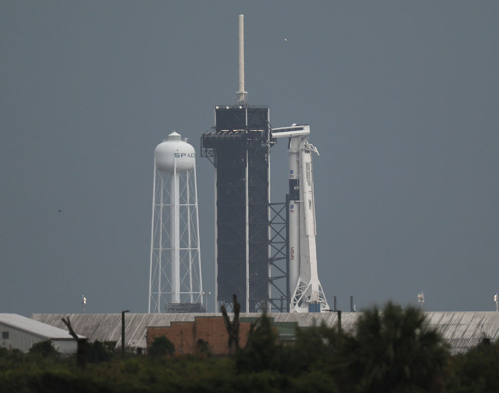 The SpaceX Falcon 9 rocket with the Crew Dragon spacecraft attached sits on launch pad 39A at the Kennedy Space Center on May 27, 2020 in Cape Canaveral, Florida. Later today NASA astronauts Bob Behnken and Doug Hurley are scheduled to liftoff on an inaugural flight and will be the first people since the end of the Space Shuttle program in 2011 to be launched into space from the United States.  (Photo by Joe Raedle/Getty Images)