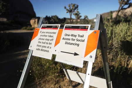 A social distancing sign in Joshua Tree National Park