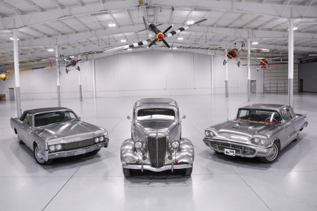 A stainless steel Ford Thunderbird, Ford Deluxe Sedan and Lincoln Continental Convertible