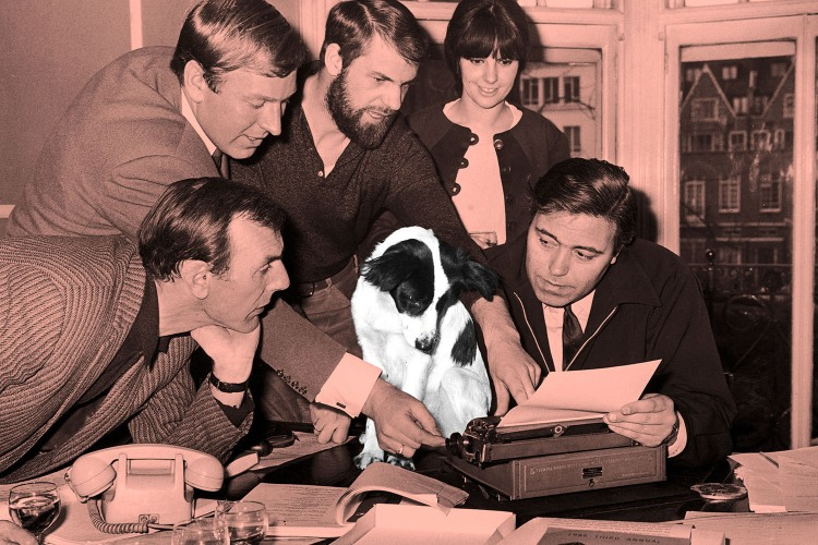 People at work gather around a dog