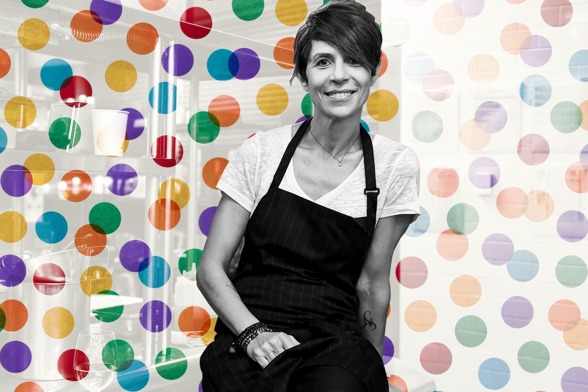 Dominique Crenn stands in front of a polka dot background