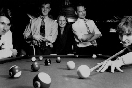 Suits playing pool, the once working class game has been taken over by Yuppies...Playing at Metropole Hotel, Cremorne, L to R... Adrian Fisk, Cameron Bryant, Cameron, Nicole Lunday, Stuart Mitchell, and Margot Clarke.. October 14, 1993. (Photo by Paul Jones/Fairfax Media via Getty Images).