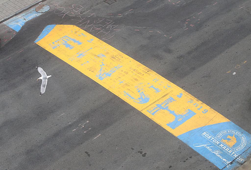A bird flies over the Boston Marathon finish line on April 20, 2020. (Suzanne Kreiter/The Boston Globe via Getty)