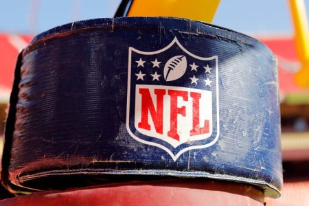 The NFL logo on a goal post stanchion. (David Eulitt/Getty)