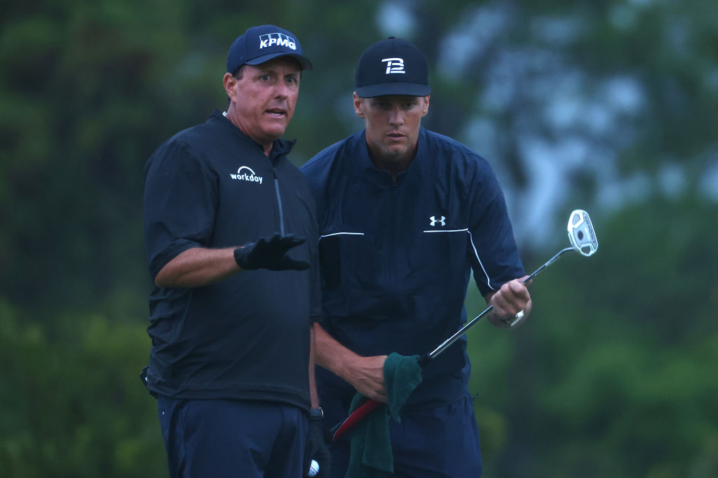 Phil Mickelson reads a putt for NFL player Tom Brady during The Match. (Mike Ehrmann/Getty for The Match)