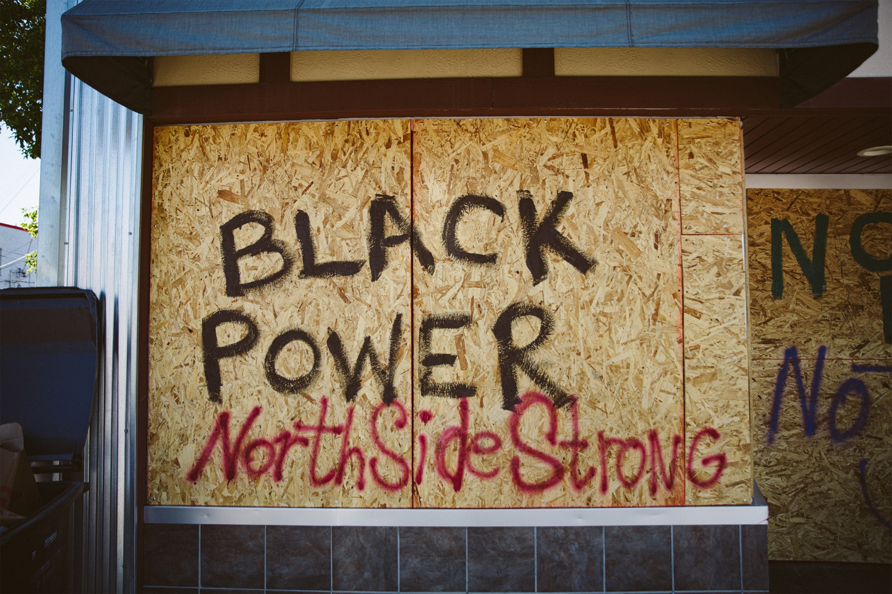 """The words """"Black Power"""" and """"North Side Strong"""" on a building in Minneapolis"""