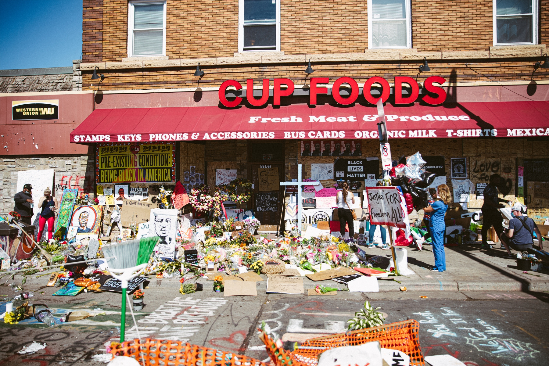 Art, flowers and protest signs outside Cup Foods in Minneapolis