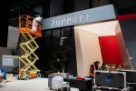 Workers dismantle the Ferrari stand the the 2020 Geneva International Motor Show