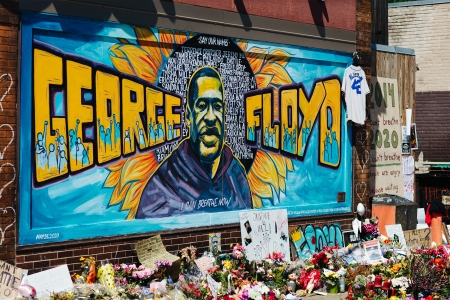 Blue and yellow mural of George Floyd outside Cup Foods in Minneapolis