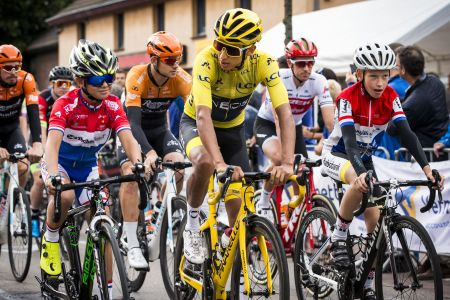 Colombia's Tour de France winner Egan Bernal cycles amidst young local riders on July 31, 2019