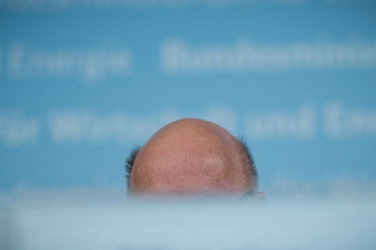 The bald head of German Economy Minister Peter Altmaier is pictured as he holds a press conference about the new amendment of the Foreign Trade and Payments Act and the overall economic development, in Berlin, on April 8, 2020, in the context of the novel coronavirus COVID-19 pandemic. (Photo by MICHAEL KAPPELER/POOL/AFP via Getty Images)